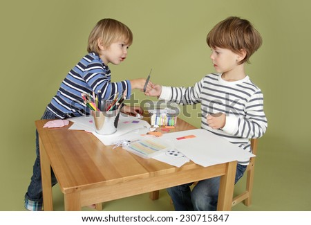 Child, kid engaged in arts and crafts activity, sharing and learning concept
