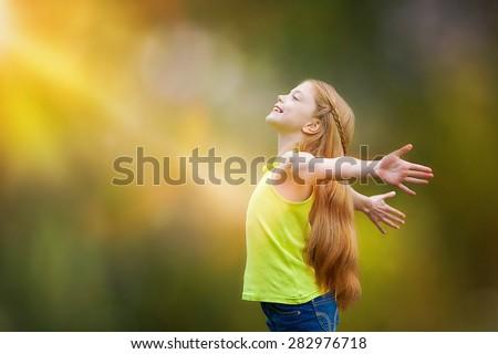 child, kid, joy, faith, praise and happiness and freedom - stock photo