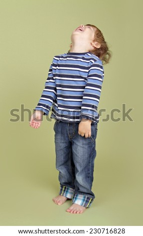 Child, kid, playing, jumping, dancing, being silly and having fun - stock photo