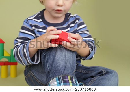 Child, kid, playing with building blocks - stock photo