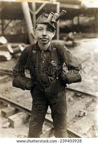 Child laborer portrayed by Lewis Hine in 1908. Tipple Boy at West Virginia coal mine, worked with the tipple, a device that tilted coal cars from the mine for unloading. - stock photo