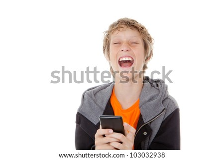 child laughing reading message on cell or mobile phone - stock photo
