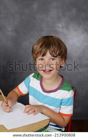 Child laughing, with blank page, learning, school or education concept