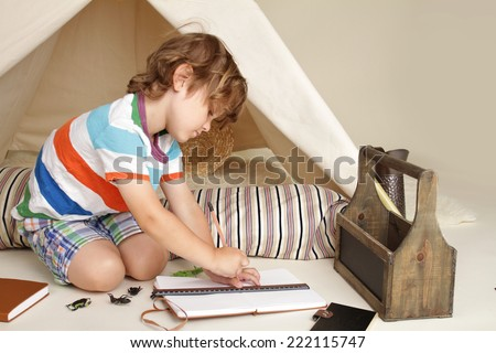 Child learning and education during indoor play: drawing and writing