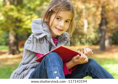 child learns in the nature - stock photo