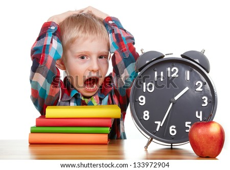 child learns the books ,clock, time concept - stock photo