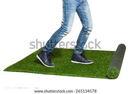 Child legs stepping on artificial grass isolated on white копи� - stock photo