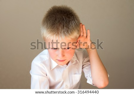 Child listening overhearing something with hand to ear concept - stock photo