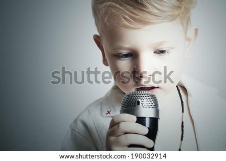 child. little boy singing in karaoke. microphone.fashion.rock singer - stock photo