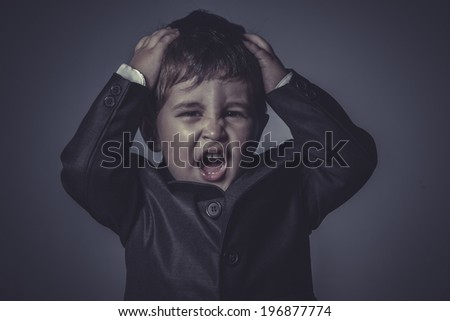 child, little business boy over grey background - stock photo