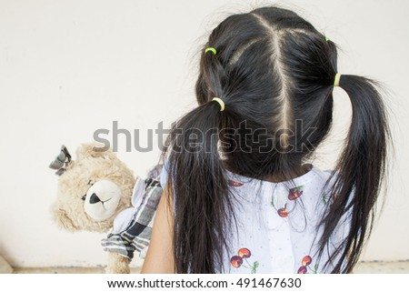 child little girl playing teddy bear