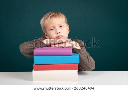 Child. Little Girl Smiling with Books - stock photo