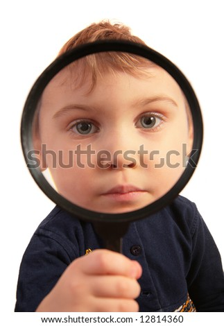 Child look through magnifier