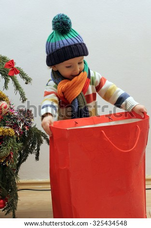 Child looking for Christmas presents - stock photo