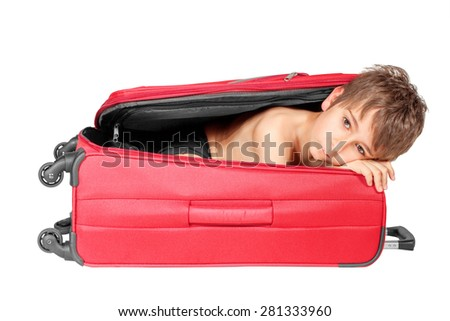 Child looking out red suitcase. Isolated on white - stock photo