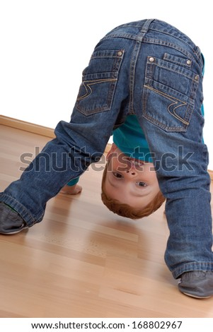 Child looking through his legs