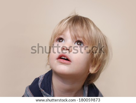 Child looking up, curiosity, close up face portrait