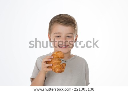 child looks at a tempting baked sweet - stock photo