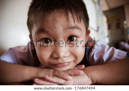 child Looks at the camera. - stock photo