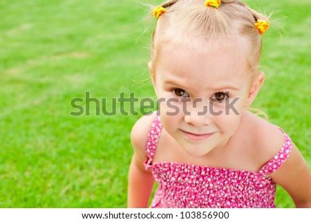 child looks into the camera - stock photo