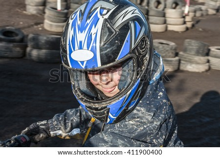 child loves to race with a quad at the muddy quad track