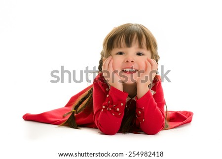 Child lying down with hands on face. - stock photo