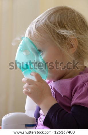 child makes inhalation - stock photo