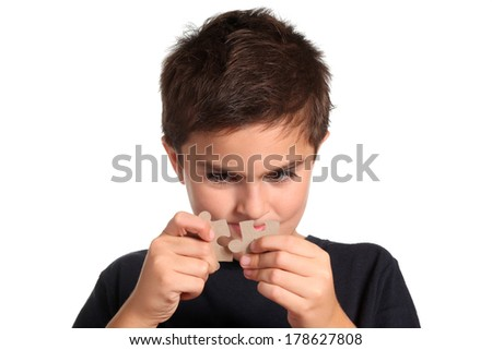 child making puzzle - stock photo