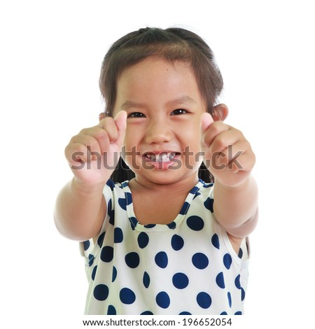 Child Making thumbs up