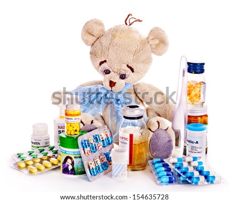 Child medicine and teddy bear. Isolated. - stock photo