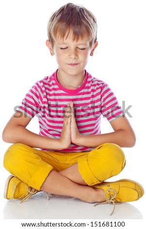 child meditates - stock photo