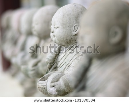 Child Monk Dolls , The Art of statue in the Temple , Chiangmai, Thailand. - stock photo