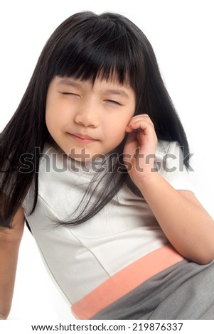 Child narrowing eyes for vision on white background