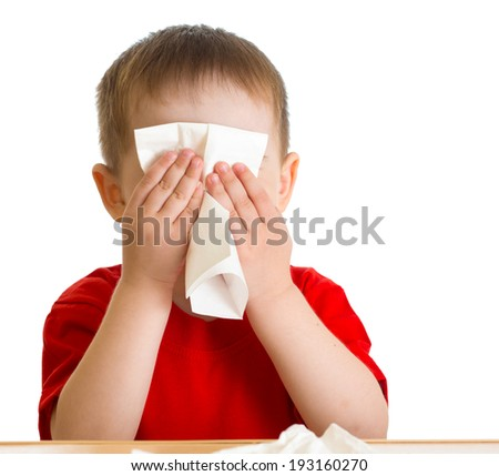 Child nose wiping with tissue - stock photo