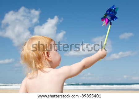 Child of the sea with spinner in the hands of - stock photo
