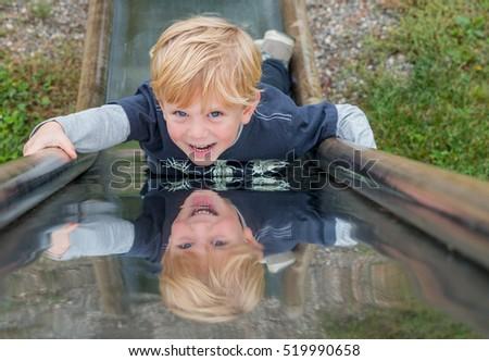 Child on a Metal Slide