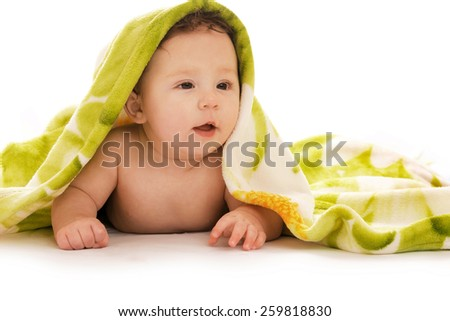 Child on a white background under a blanket