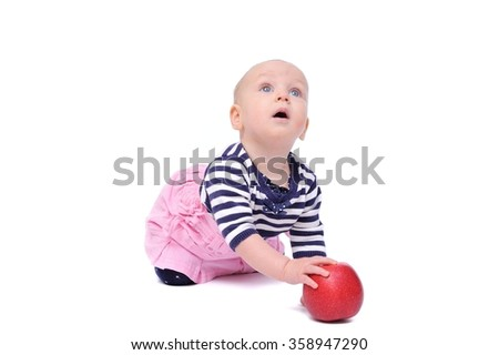 child on a white background with an apple/charming child with an apple on a white background - stock photo