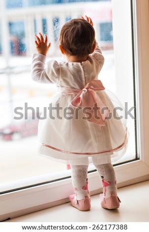 child on a window - stock photo