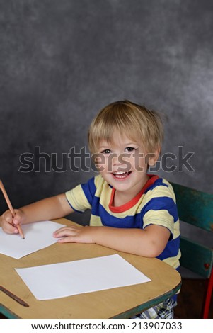 "Child on chair in classroom with a blank page, ""back to school"" theme,"