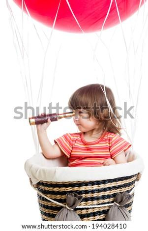 child on hot air balloon watching through spyglass - stock photo