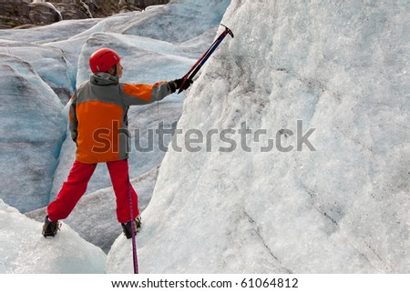 child on ice of Norwegian glacier - stock photo