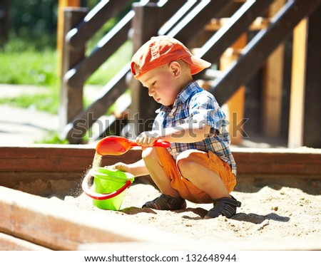 Child on playground in summer park - stock photo