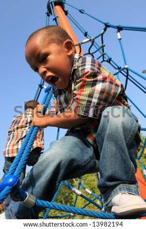 Child on Ropes - stock photo