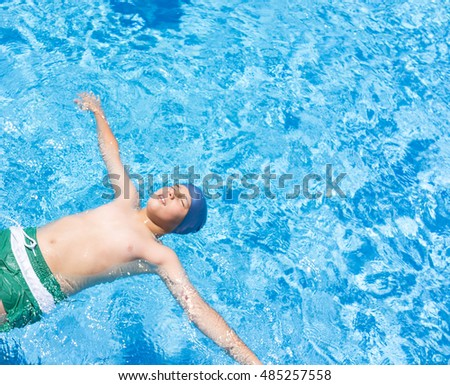 Child on summer swimming pool vacation having fun and happy life time