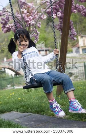 Child on swing - stock photo