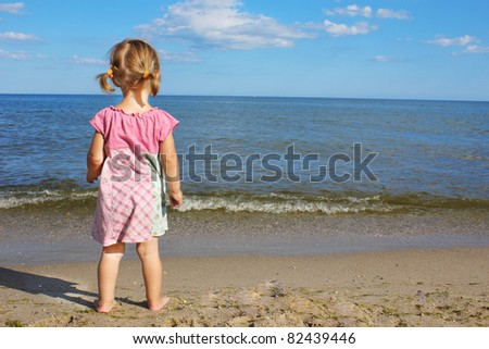 child on the banks of the sea
