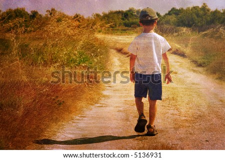 Child on the road - stock photo