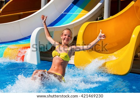 child on water slide aquapark hand stock photo (royalty free