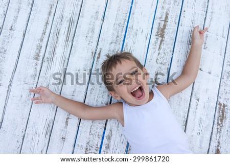 Child on white wooden background - stock photo